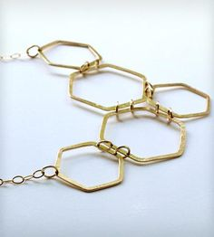 Hexagons galore, this asymmetric necklace offers just about everything one could want in a necklace.
