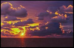 Bible Verse of the Day an ocean sunrise through heavy clouds, Melbourne Beach, Florida and John 8:12.