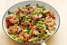 Get Cajun Shrimp and Rice Recipe from Food Network. Sub lettuce / greens for rice and make it a Cajun shrimp salad! Shrimp Dishes, Rice Dishes, Food Network Recipes, Cooking Recipes, Healthy Recipes, Cooking Corn, Cooking Salmon, Flour Recipes, Kitchen Recipes