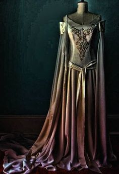 The City of Tiliathine usually dresses in white, purple, gold, or brown. At Araina's arrival, this dress is provided for her. Her old one had been destroyed seeing as a pack of Death's servants pursued her all the way to the City.