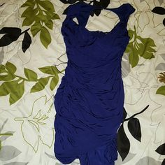Beautiful purple Forever 21 fitted dress!!! This dress looks blue in picture but it is a gorgeous purple color. It is lined and fits more like a medium. There is gathering on the sides and back where the zipper is at. Forever 21 Dresses Mini