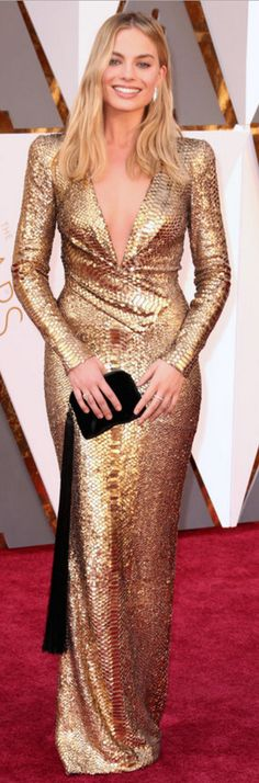Who made Margot Robbie's gold wrap gown, shoes, and black fringe handbag?