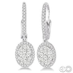 Crafted In Cool 14 Karat White Gold, These Earring Features A Cluster Of 20 Invisible Set Round Cut Diamonds In Oval Shape Bordered With A Frame Of Dazzling 68 Prong Set Round Cut Diamonds Along With The Front Edge. These Treats Closes With A Secure Clasp. Total Diamond Weight Is 5/8 Ctw. Price: $1,649.00