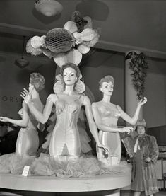 """December 1942. """"New York. Corset display at R.H. Macy & Co. department store during the week before Christmas."""" Behold the $12.29 """"average figure"""" corselette. Photo by Marjory Collins for the Office of War Information.  Join Us: 1942"""