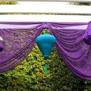 Purple curtain with turquoise lantern #peacock #wedding #decor