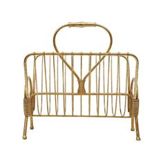 This magazine rack is just as stylish as the fashion mags you'll fit into it. A bright gold finish highlights an elegant, minimal metal wire style with textural wrapped accents. It's just right for tuc...  Find the Elsie Magazine Rack, as seen in the The Retro Office Lounge Collection at http://dotandbo.com/collections/the-retro-office-lounge?utm_source=pinterest&utm_medium=organic&db_sku=105072