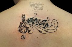 Musical tattoo by Miguel Angel tattoo, via Flickr