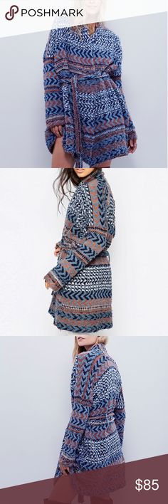 """FREE PEOPLE Iona Wrap Cardigan In an oversized, slouchy silhouette, this super soft chunky knit cardi is in a fun pattern. Adjustable waist tie.  Free People  84% Cotton 5% Rayon 5% Nylon 4% Acrylic 1% Wool 1% Alpaca Hand Wash Cold Import Bust: 51.0"""" = 129.54 cm Length: 32.0"""" = 81.28 cm Sleeve Length: 34.0"""" = 86.36 cm Free People Sweaters Cardigans"""