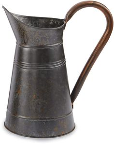 The farmhouse galvanized tin pitcher features generous sized handle with copper finish detail. Water Carafe, Ceramic Pitcher, Mud Pie, Galvanized Steel, Vintage Farmhouse, Joss And Main, Milk Glass, Glass Bottles, Stoneware