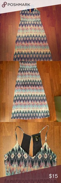 Easter maxi dress Perfect dress for Easter!!! The back is amazing- side cutouts and a button closure make a beautiful design on back of dress (last picture). Worn 4/5 times but it great condition. It is lined to the knee. Forever 21 Dresses Maxi