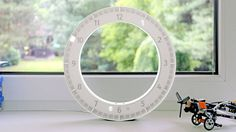 Clever Minimalist Circle Clock  The design KIBARDIN is behind a minimalist circle clock called The Only Clock. She can be put on a wall or a table before a window to see the evolution of the time during a day and the evolution of the light. It shows the hours in a digital way and minutes are materialized with sixty little box enlightened by sixty LEDs. The object reproduces the mechanism of analog clocks in a digital way. There is currently a crowdfunding concept.              #xemtvhay