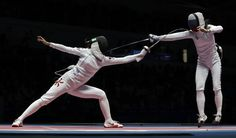 Man Wai Vivian Kong of Hong, left, competes with SHUTOVA Lyubov Shutova of Russia compete in the women's individual epee event at the 2016 Summer Olympics in Rio de Janeiro, Brazil, Saturday, Aug. 6, 2016. (AP Photo/Andrew Medichini)