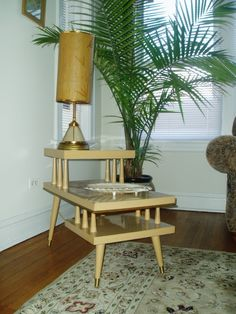We had these style tables when I was a small child...eww...mid century modern...