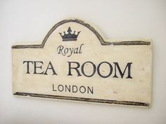 """Kitchen signage?    It's 4 O'clock somewhere - time for tea! Inspired by the tea shops of old London Town, this original vintage style sign would make a great addition to any room. The sign is hand painted with layers of all-natural and environmentally friendly milk paint with gold detailing that is chippy and distressed (each will have its own variation of distressing). It measures 28"""" x 16"""". Painted white on the back and hangs by a wire for easy display. $65"""