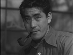 There is just something about a man with a pipe...... the very handsome Toshiro Mifune.