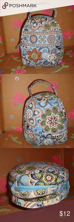 Vera Bradley Lunch Bag Vera Bradley Lunch Bag  In good used condition.  Small spots from use over the years, nothing too distracting at first glance.   Difficult to photograph these imperfections.  Marks inside are more noticable, but will probably be easily removed with a Mr. Clean Eraser.   Retired Pattern Summer 2009 - Bali Blue Vera Bradley Bags Totes