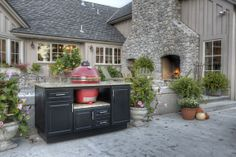 The Oxford Island built to hold your Big Green Egg, Kamado Joe or Primo Grill. Cabinet from Select Outdoor Kitchens.