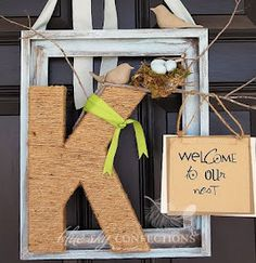 Unique Front Door Wreath - Wooden letter, bird & nest from craft store, Frame from 2nd hand store...  Use Twine or Ribbon to wrap around the wooden letter.