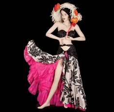 "Marilyn Monroe ""Vicky"" tropical print pink, black and white skirt, black halter top and hat from ""Heat Wave"" number by Travilla for There's No Business Like Show Business. (TCF, 1954) (Sold for 615 thousand dollars at the Debbie Reynolds Auction 6/18/2011)"