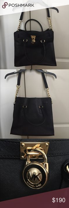 Michael Kors Hamilton Bag Gorgeous black leather Hamilton bag with gold hardware. Never used, it's been in its original dust bag in storage. Comes with original dust bag—the dust bag itself has pulls in the fabric since it is a delicate material, but has never been mishandled. Michael Kors Bags Satchels
