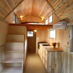 Aspen Tiny Home by Simblissity 003. Looking from the living area toward the bathroom. Good space under stairs for the fridge and a closet.