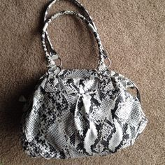 BRAND  ELLE Faux Snake Skin Purse -Used a handful of times  -Front pocket on exterior  ☑️ Bundles are encouraged  No trades. I will NOT answer to this comment. ❌No offers in comments No asking lowest Offer No paypal, etc No holds ❗️All sales FINAL, no exceptions  ‼️Please remember the fees PM takes out. Be courteous and stay classy. ‼️ LOW BALL OFFERS WILL BE IMMEDIATELY DECLINED. Don't offer $10 for an $80 item, it's rude and wastes not only your time but the seller's time. Elle Bags…