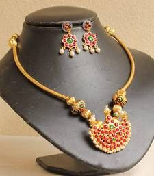 The product includes a necklace and a pair of earrings studded with simulated pearls