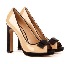 Classic peep toe pump with flared heel and bow detail