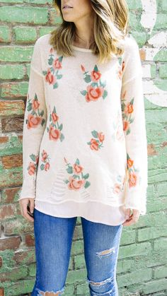 This delicate floral sweater is a beautiful everyday timepiece.
