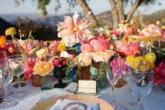 Love the mismatched vases/glasses that the flowers are in   Photography: Next Exit Photography - nextexitphotography.com  Read More: http://www.stylemepretty.com/little-black-book-blog/2014/11/17/hint-of-whimsy-saddlerock-ranch-wedding/