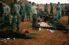 Wounded soldiers being treated outside tents. Vietnam