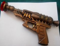 paint, a dollar store water gun, and a few odds and ends make an awesome steampunk-inspired ray gun