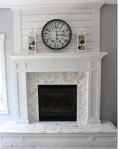 our fireplace has shiplap above, a floating wooden mantle, and a cased hearth area that we need to tile on top of like this