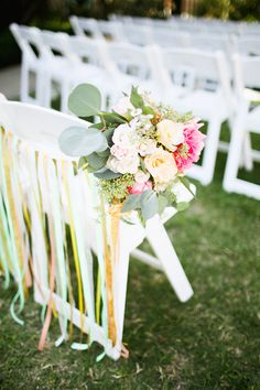 fabric streamers and flowers for ceremony seats, photo by Adrienne Gunde http://ruffledblog.com/christmas-house-inn-wedding #weddingideas #ceremonies