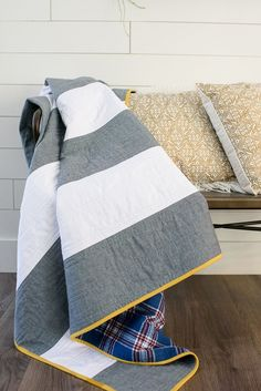 Winter Blankets. Quick and easy quilt pattern. free quilt pattern. Modern striped quilt perfect for a handmade Christmas gift. Sponsored Post.