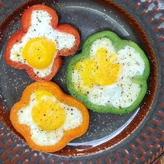 """Eggs Cooked in Peppers    Ingredients:    Fresh Eggs  3 large peppers, one green, one red, one yellow  salt & pepper  Pam, oil or margarine (your choice)    Steps:     Remove seeds etc from peppers; slice peppers into """"rings"""" about 3/4″ in width.  Coat frying pan with Pam, a small dollop of margarine or 1/2 tsp of oil (brush oil around pan)  Place one ring of each color into hot pan, immediately drop one egg into each pepper ring and cook until sunny side up to your taste!"""