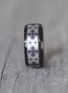Black tungsten ring with cross design.