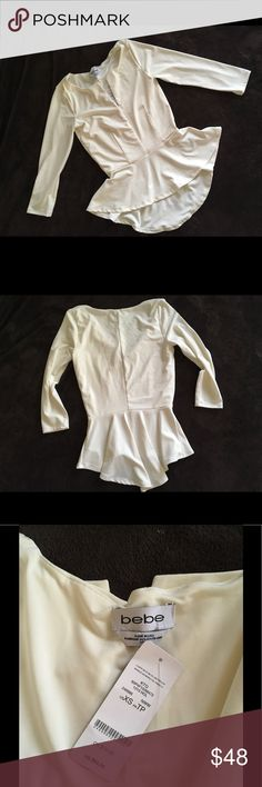🆕 Bebe peplum top Gorgeous lux feel bebe peplum top in ivory! The perfect blend of materials for a body contouring fit. 3/4 sleeves. High/low hem with v neck. Size xs, new with tags! bebe Tops Blouses