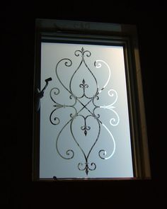 Cordoba - sandblasted decorative etched glass window ironwork motif by Sans Soucie Art Glass.