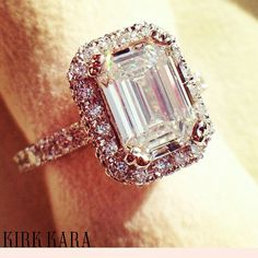 This radiant emerald cut diamond adorned with a glamorous halo catches the eye.