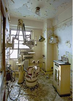 Abandoned Dentist's office in Detroit, MI. When I see abandoned properties in Detroit, I wonder why they haven't been stripped at least for scrap metal.