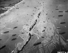 An aerial view of a harbor created to supply the invasion of Normandy. (June 1944) Photograph via the U.S. War Department