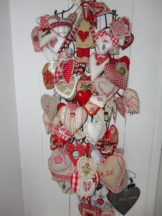 Pinned for an idea - use old wood hanger as a display piece for hanging all my heart ornaments and such.