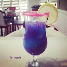 THE GALAXY COCKTAIL ~ *Purple Layer: Tequila, Blue Curacao, Lemonade, Grenadine, Ice, Blend *Blue Layer: Blue Curacao, Triple Sec, Vodka, Lemonade, Ice, Blend, Rim with Pink Sugar