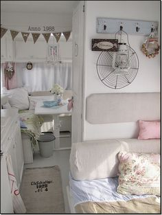 Pretty pretty vintage caravan interior I am loving that white!