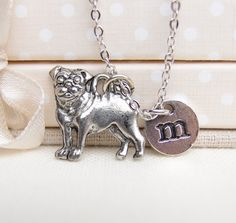 personalized pug necklace, silver pug charm, pet jewelry, doggy jewelry, kids initial necklace, pug dog pendant, small dog charm by madebypepper on Etsy https://www.etsy.com/listing/177326129/personalized-pug-necklace-silver-pug