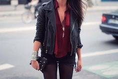 Leather jacket outfit- black tights and dark shorts, maroon top