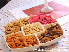 kiddie tray for one year old party with baby puffs, animal crackers, goldfish crackers, bunny-shaped graham crackers, and cheerios