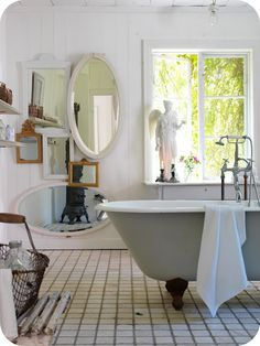 Beautiful white bathroom with great mirror collection!