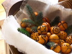 Clementine and Clove Pomanders- Put in a clear trifle bowl and display in the kitchen as a centerpiece!  Aroma is wonderful!